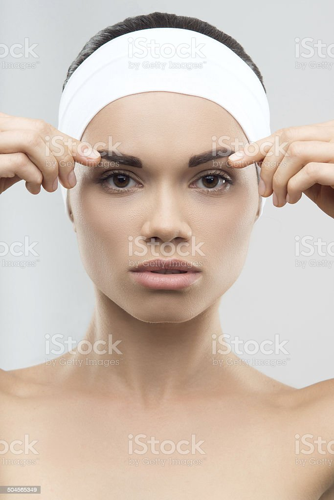 Measuring the correct proportion of eyebrows. Plastic surgery co stock photo