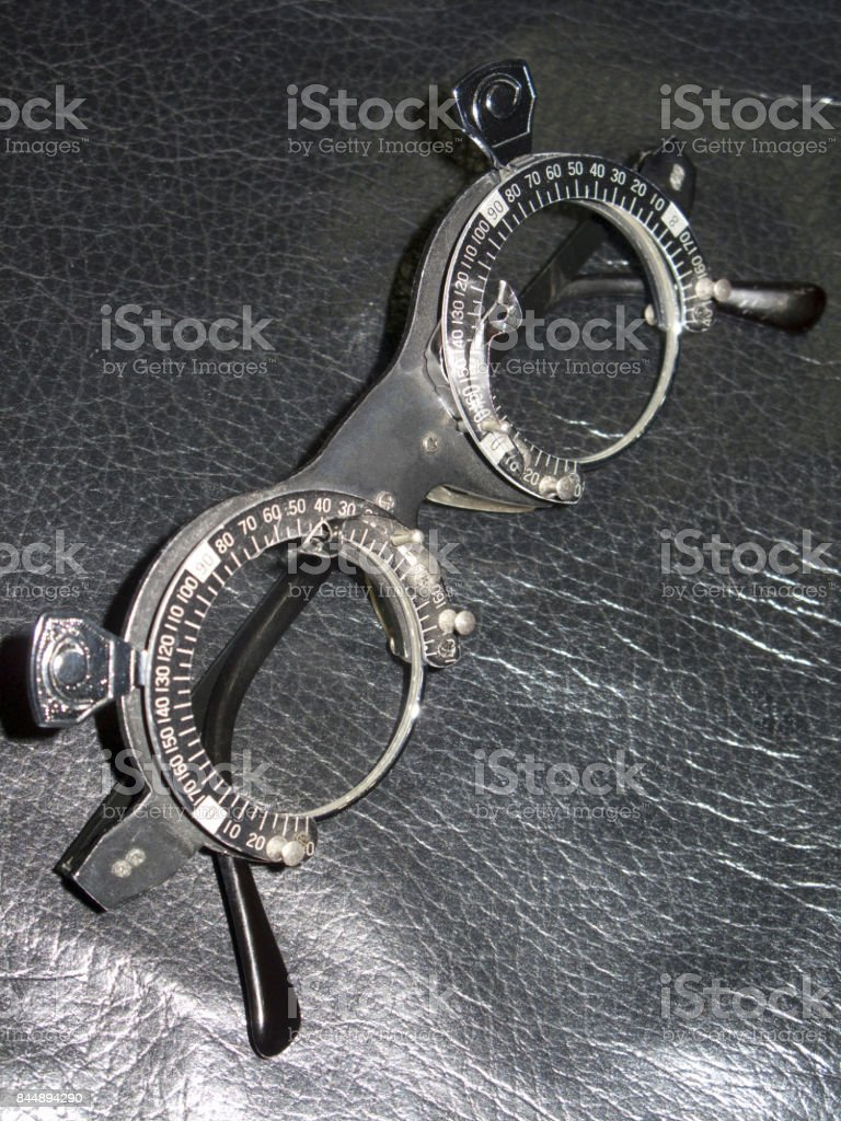Measuring the diopter glasses stock photo