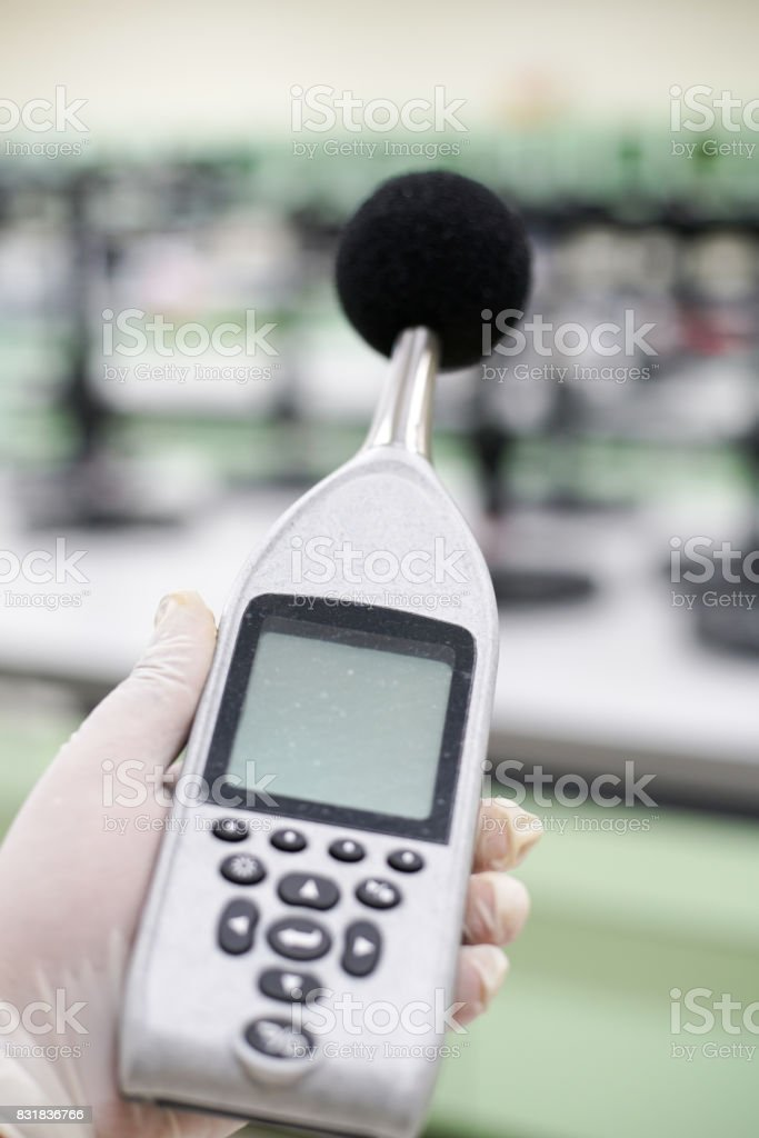 Measuring the noise in laboratory room with a sound level meter. stock photo
