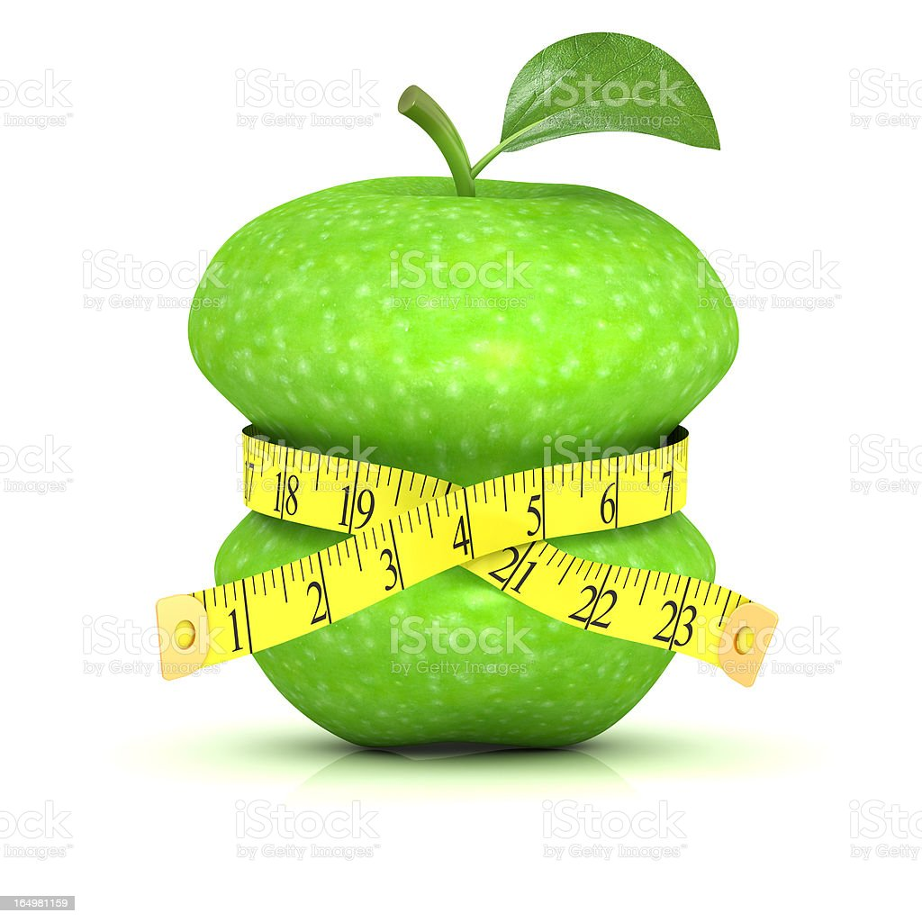 Measuring the waist of an apple with measuring tape royalty-free stock photo