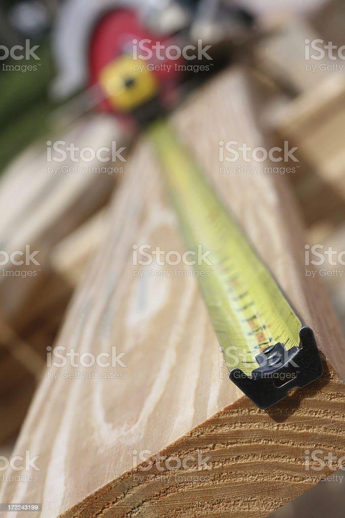 Measuring up Lumber royalty-free stock photo