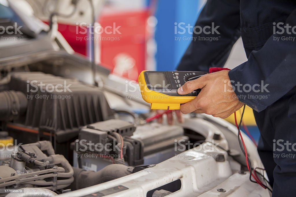 Measuring voltage of a battery royalty-free stock photo