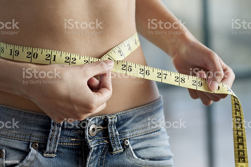 Measuring waist close up stock photo