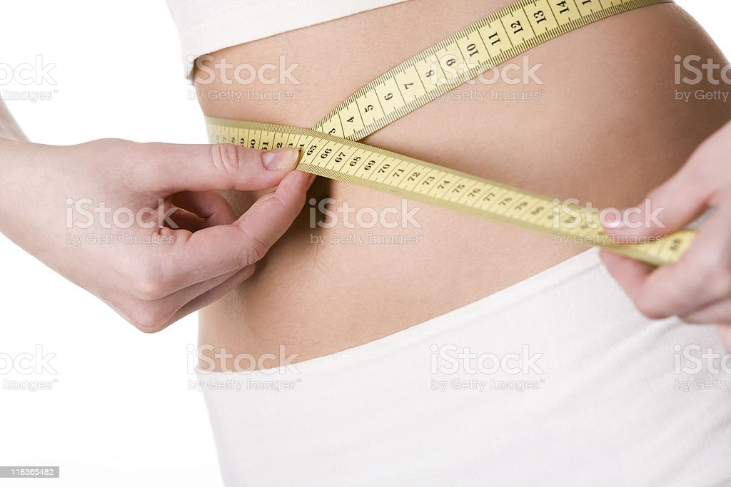 Measuring waist royalty-free stock photo