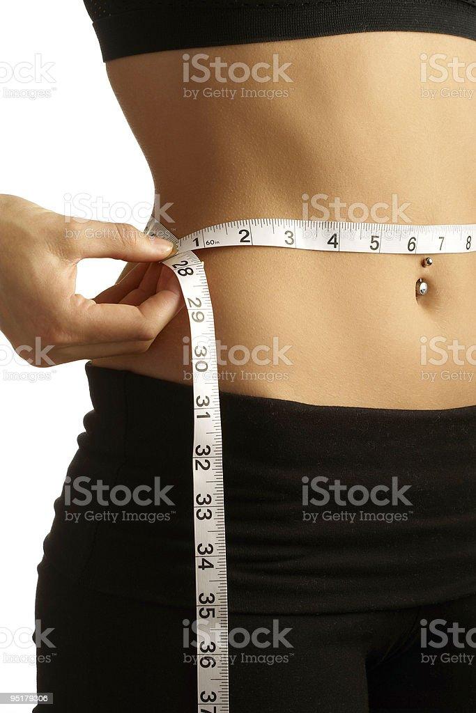 Measuring waistline royalty-free stock photo