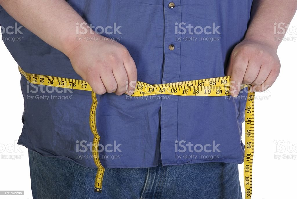 Measuring Weight Loss royalty-free stock photo