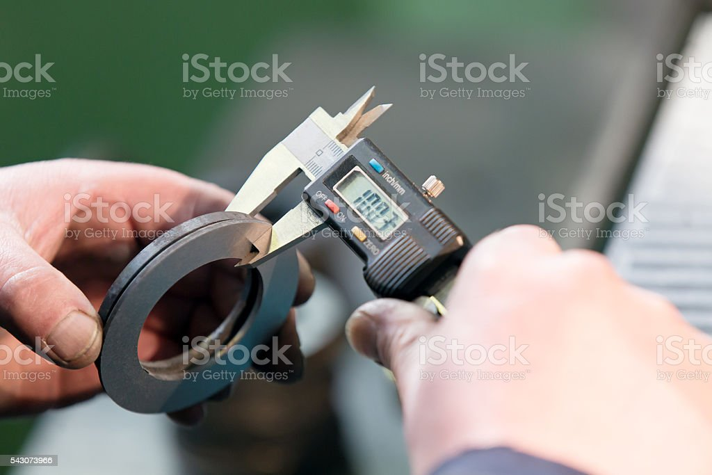 Measuring with Digital Vernier Caliper stock photo
