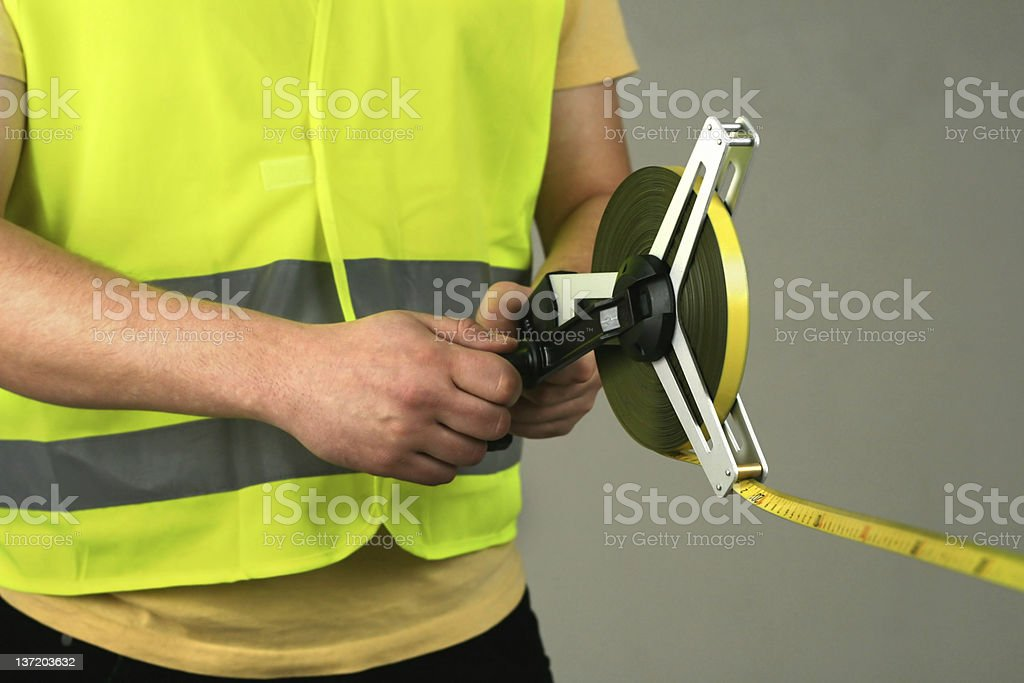 Measuring with tape royalty-free stock photo