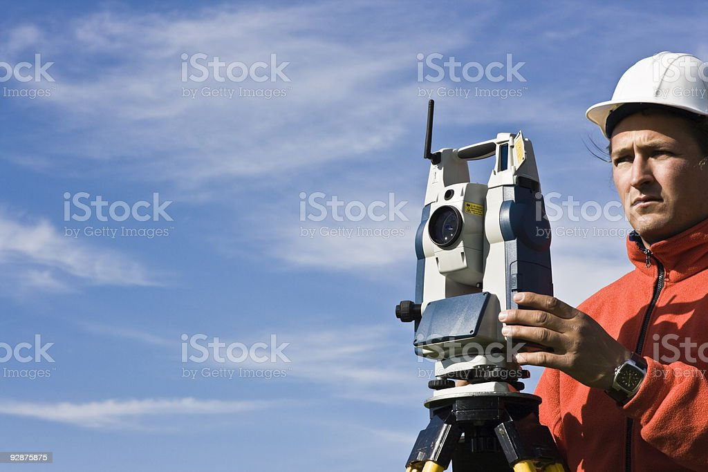 Measuring with theodolite royalty-free stock photo