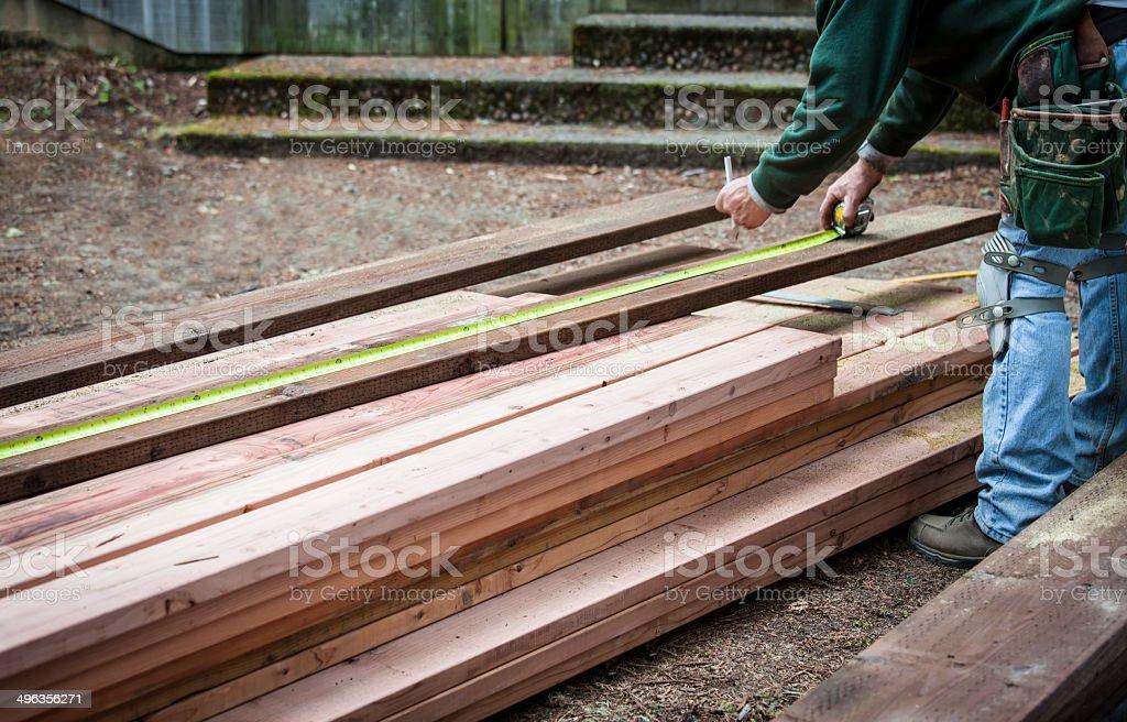 Measuring wood stock photo
