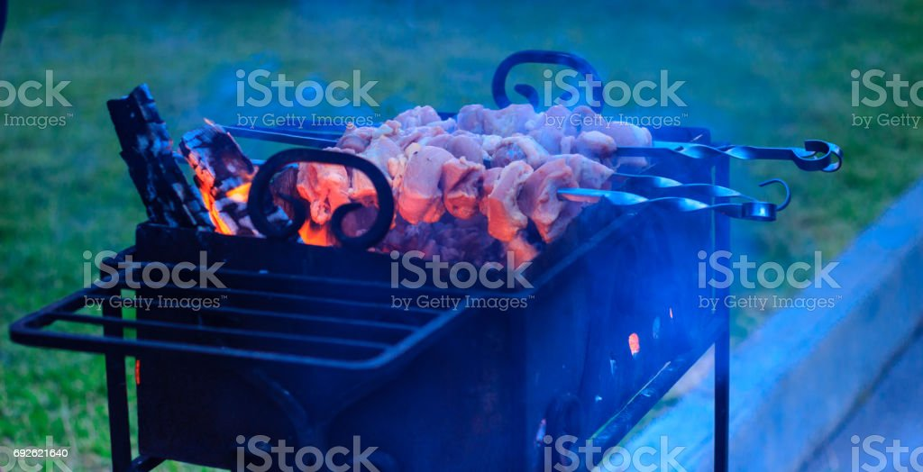 Meat and smoke curtain stock photo