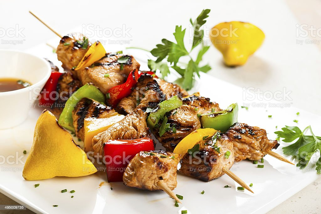 meat and vegetable kebabs stock photo