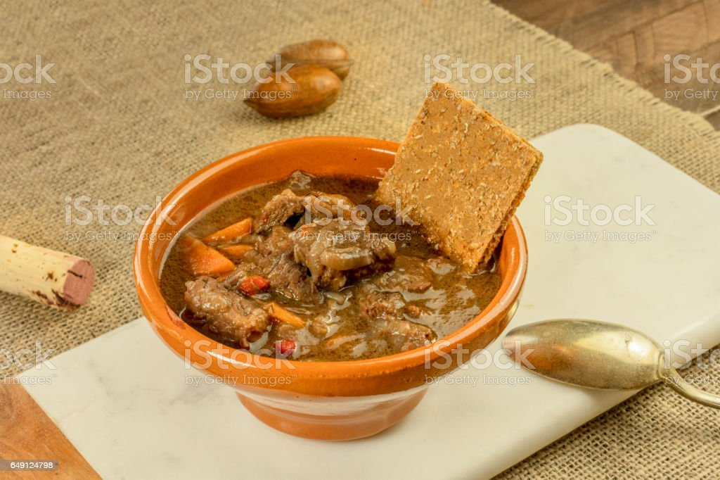 Meat and vegetable stew in earthenware bowl stock photo
