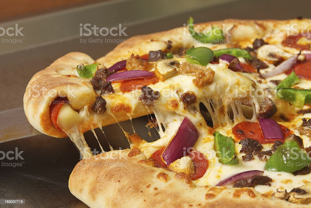 Meat and Vegetable Stuffed Crust Pizza royalty-free stock photo