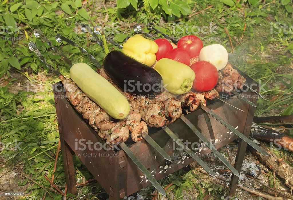 Meat and vegetables are roasted on the grill royalty-free stock photo