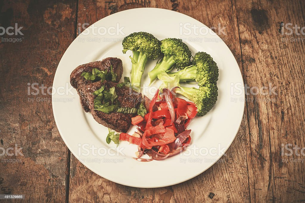 Meat and vegetables on plate stock photo