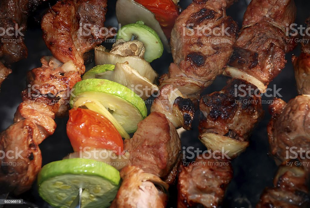 Meat and vegetables prepares on fire royalty-free stock photo
