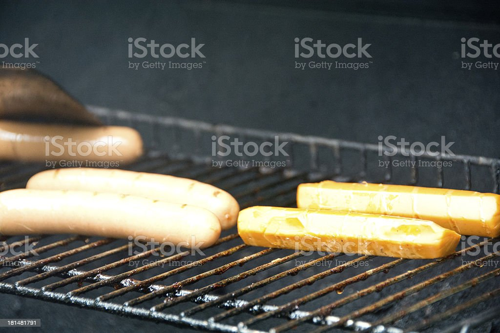 Meat and vegetarian hotdogs on a grill royalty-free stock photo