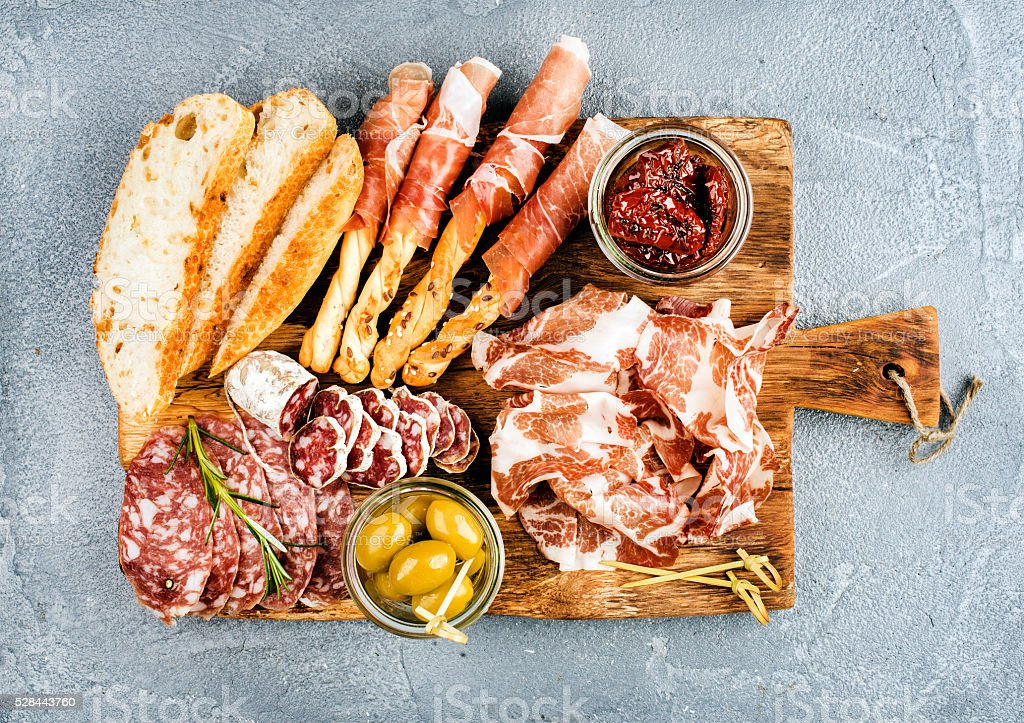 Meat appetizer selection or wine snack set. Variety of smoked stock photo