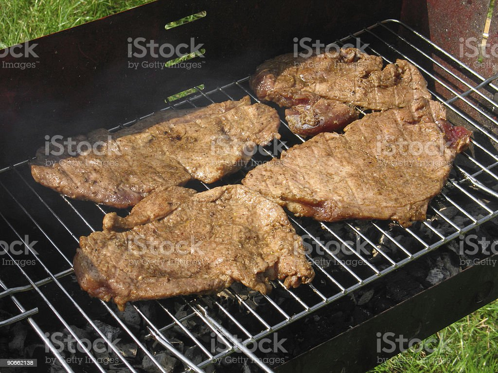 Meat at grill stock photo