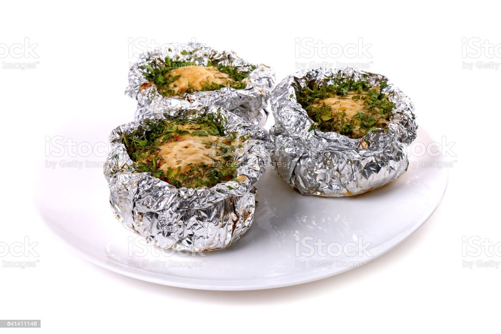 Meat baked in foil stock photo