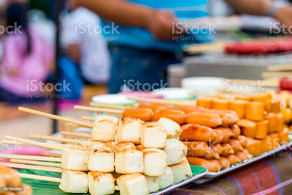 Meat ball and sausage with bamboo stick stock photo
