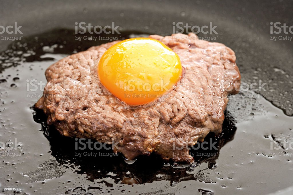 Meat ball with yolk on top, frying stock photo