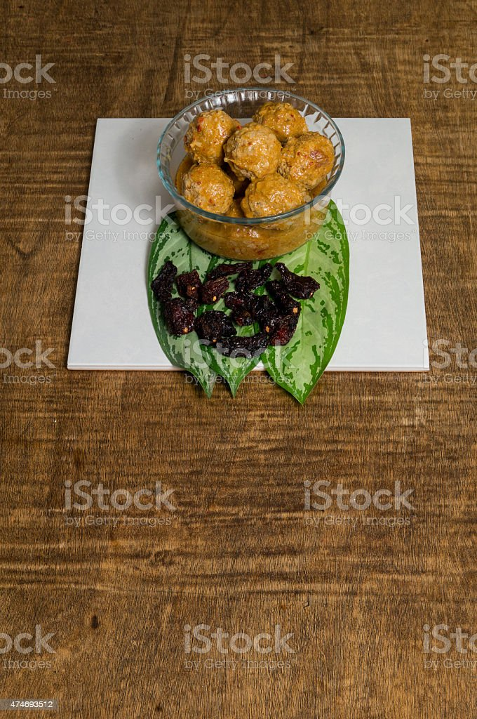 Meat balls served in bowl with dry chipotle chili stock photo