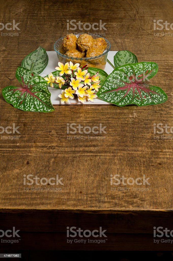 Meat balls served with mayflowers bouquet. Mexican food. stock photo