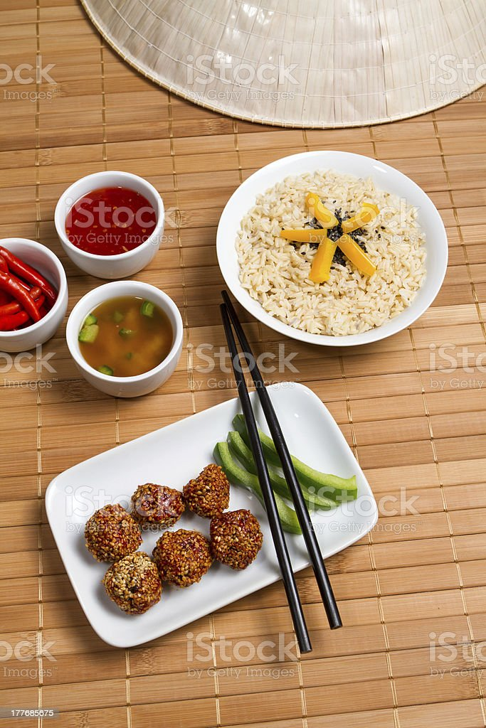 Meat balls with sesame and dark rice royalty-free stock photo