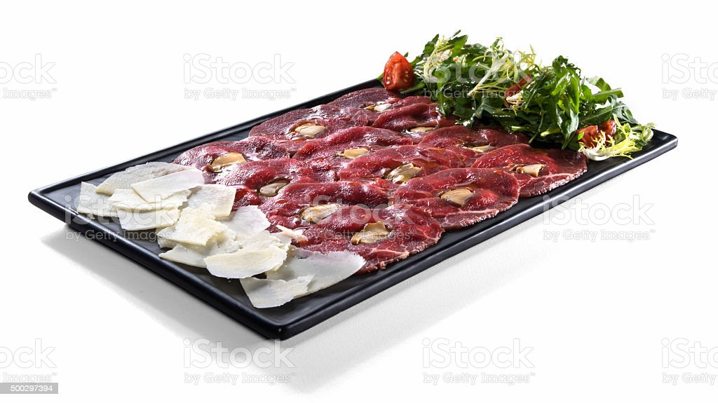 Meat carpaccio with parmesan and salad isolated on white stock photo