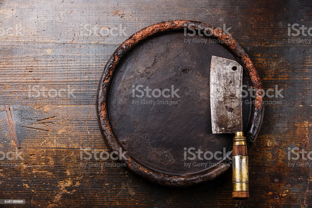 Meat cleaver and stone block background stock photo