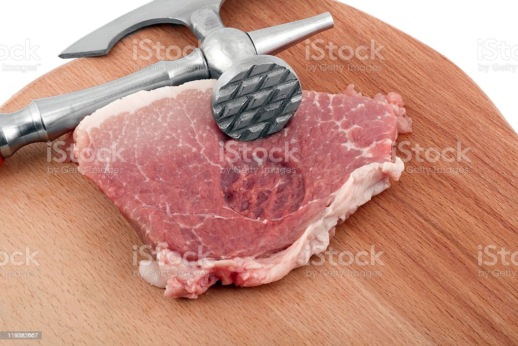 meat cleaver in fresh pork chops royalty-free stock photo