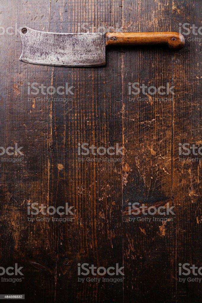 Meat cleaver on wooden background stock photo