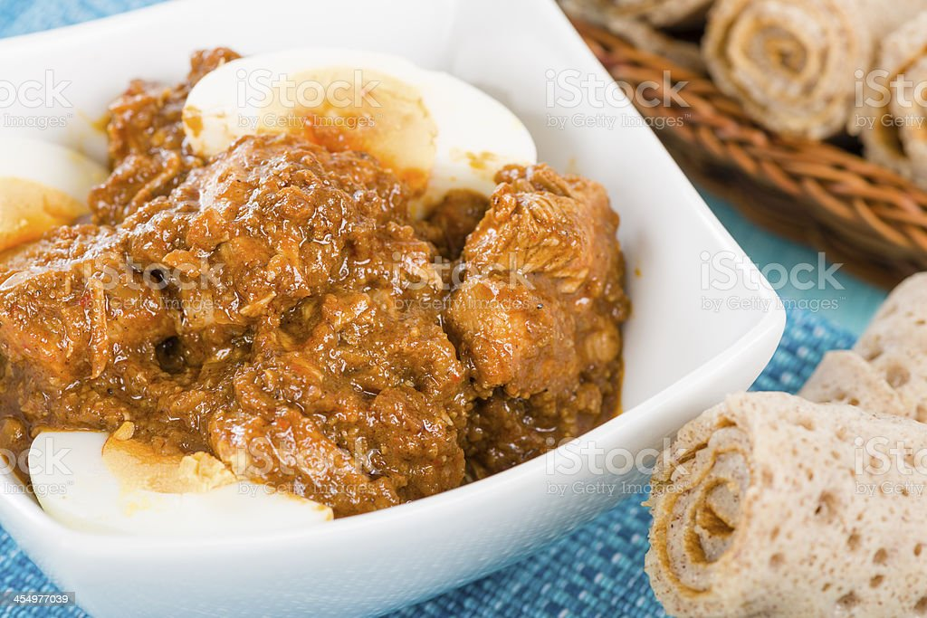 Meat curry with egg and rolled bread stock photo