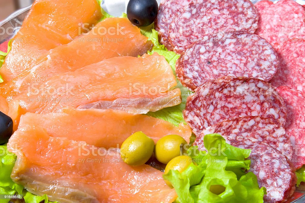 Meat delicacy with lettuce and olives stock photo