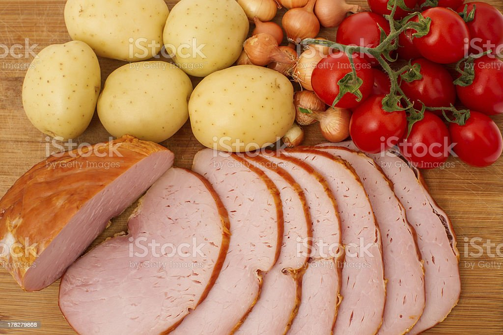 meat delicious and slices on wooden board royalty-free stock photo