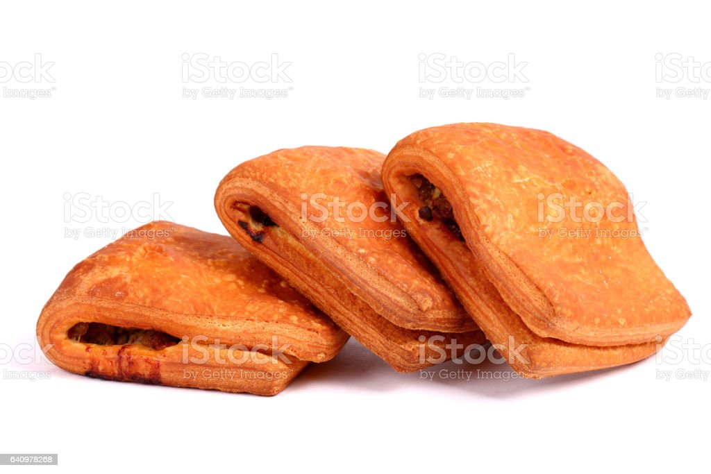 Meat filled puff pastry strudels stock photo