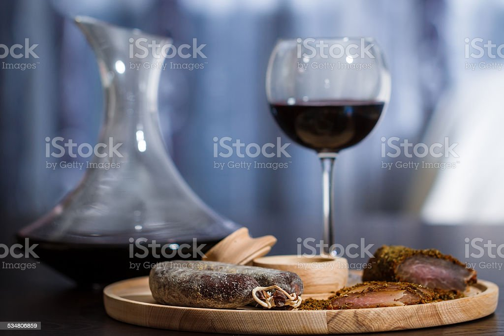 Meat fillet sausage and red wine stock photo