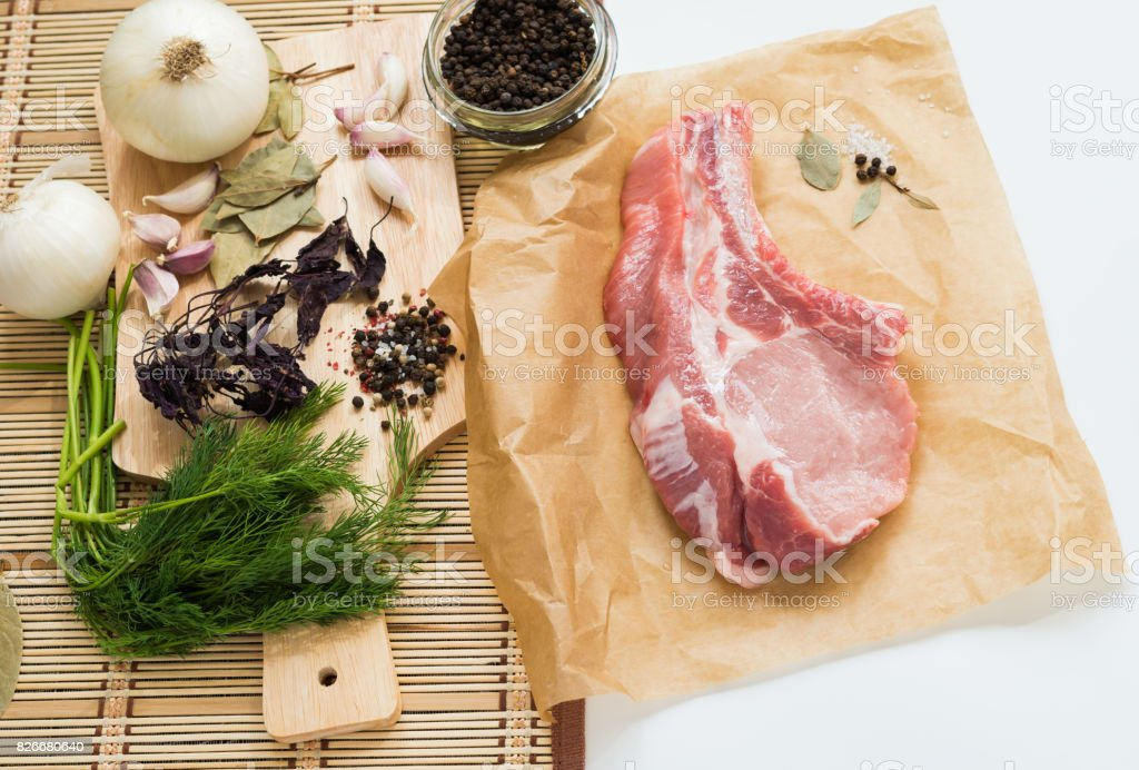 Meat. Fresh raw pork and spices prepared for cooking. Ribeye Steak stock photo