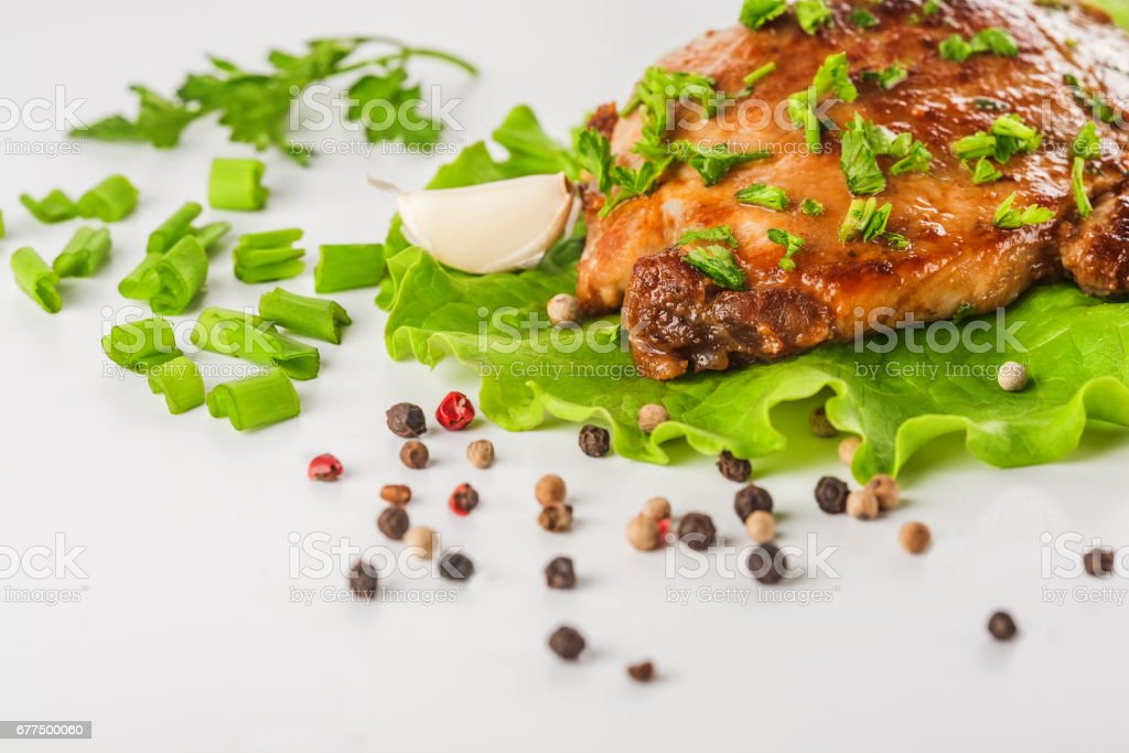 meat garlic onion pepper on white background stock photo