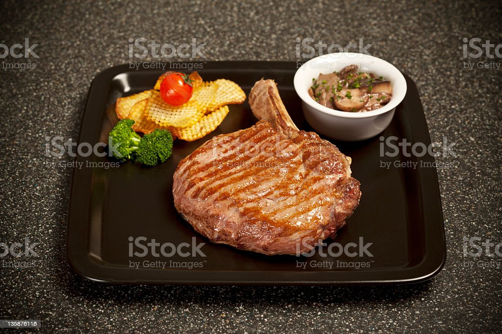 meat in the black plate stock photo