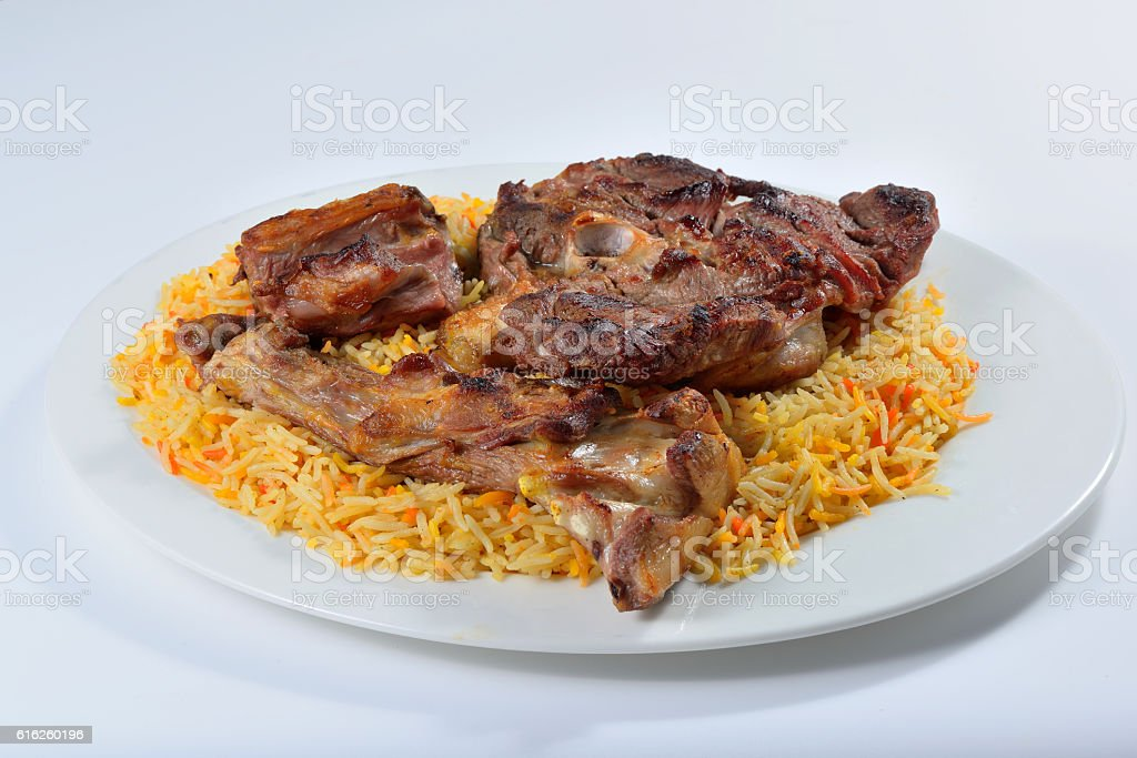 Meat madfoon or madhfoon traditional arabic rice food stock photo