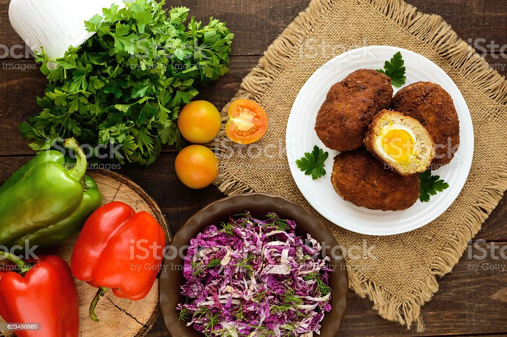Meat mini-rolls  with boiled egg and salad of chinese cabbage stock photo