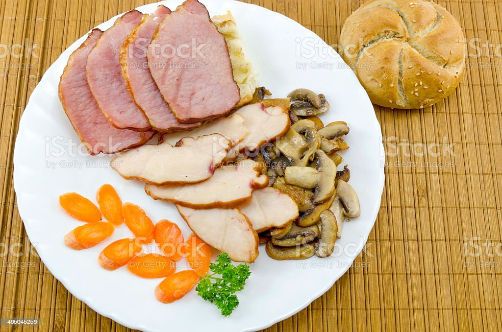 Meat, mushrooms and carrots and a bannock royalty-free stock photo