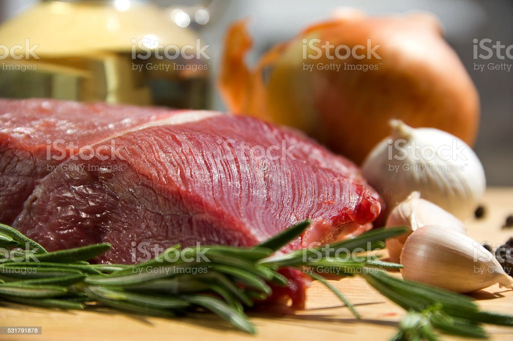 Meat on a cutting desk with spices stock photo