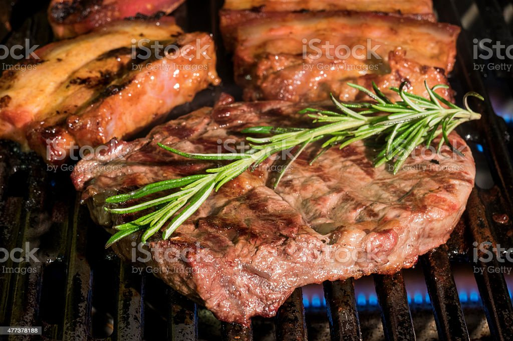 Meat on the barbecue stock photo