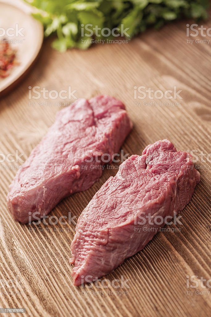 Meat on wooden table royalty-free stock photo