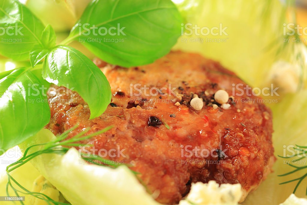 Meat patty on lettuce leaves royalty-free stock photo