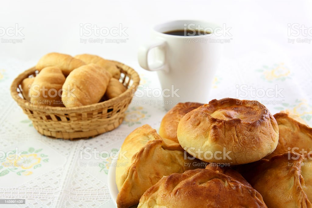 Meat pie, croissant and cup of coffee stock photo